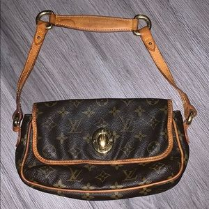 Very damaged, very authentic Louis Vuitton Purse